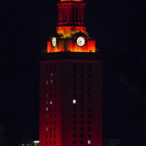Orange lights shine on the UT Tower