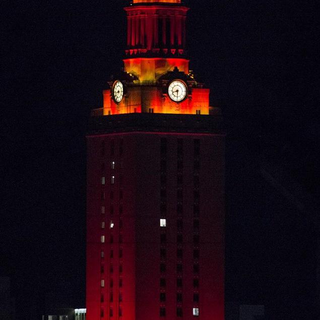 Orange lights shine on the UT Tower
