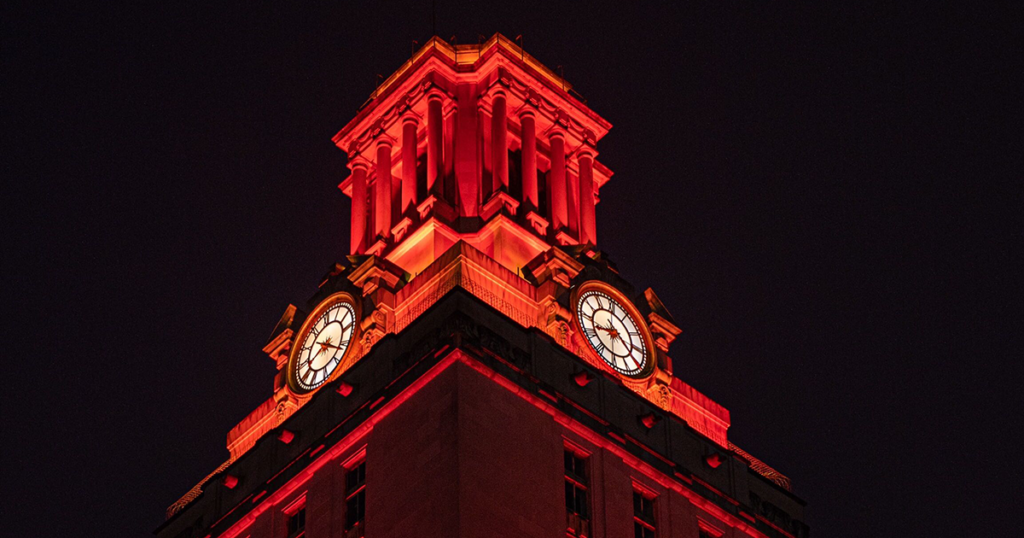 The top of the UT Tower is covered with burnt orange lights