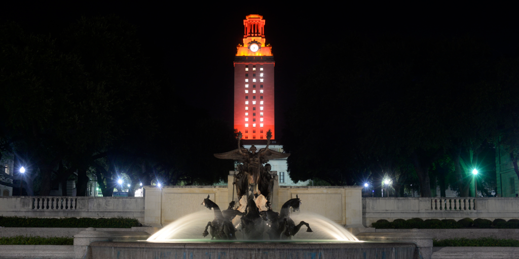 "UT Tower shines with burnt orange lights and ""20"" on its side"