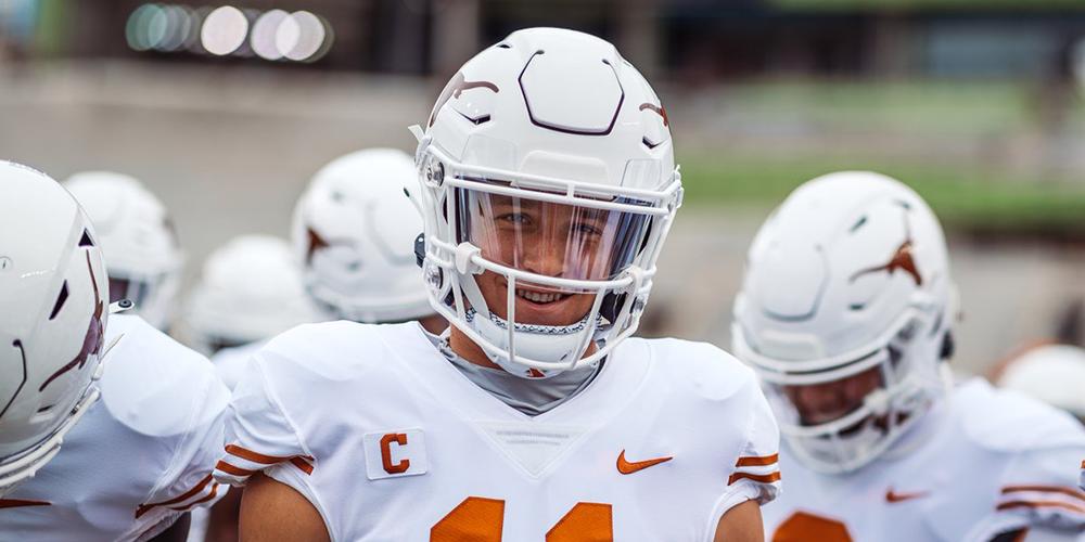 Texas Football Quarterback Sam Ehlinger smiles
