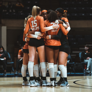 UT volleyball team in a huddle