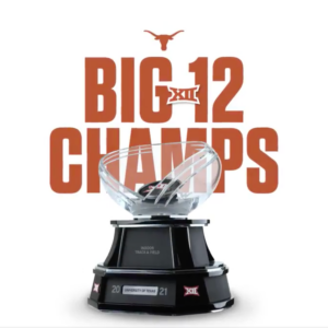 """A trophy with text that says """"Big 12 Champs"""" and shows the Texas Longhorn logo"""