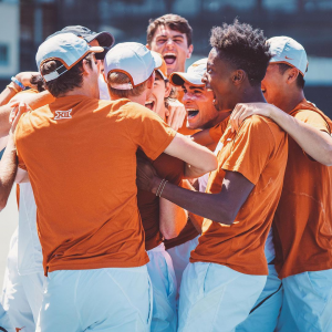 Student Athletes on the Men's Tennis team smile and join together in celebration.